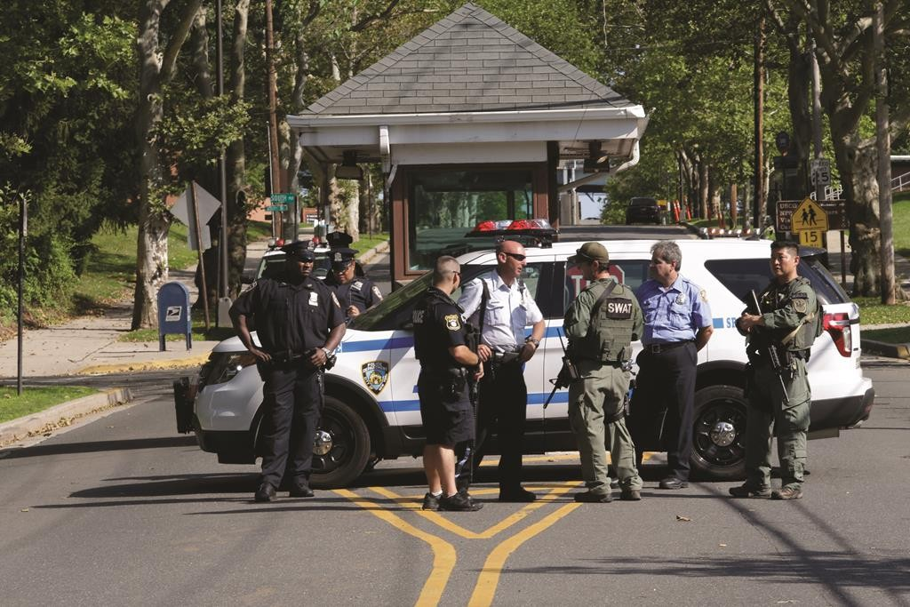 Officers stand guard on Friday in Staten Island after reports of people wielding assault rifles. (AP Photo/Mary Altaffer)