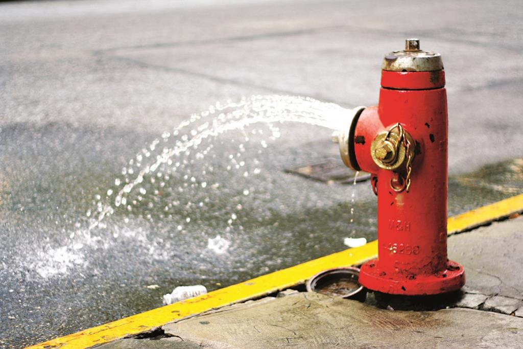 An open hydrant in New York City, spilling its contents for nobody's enjoyment. (Flickr/Nicholas Noyes)