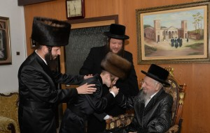 A recent photo of the Rebbe with a grandson on the day of his  bar mitzvah.  (JDN)