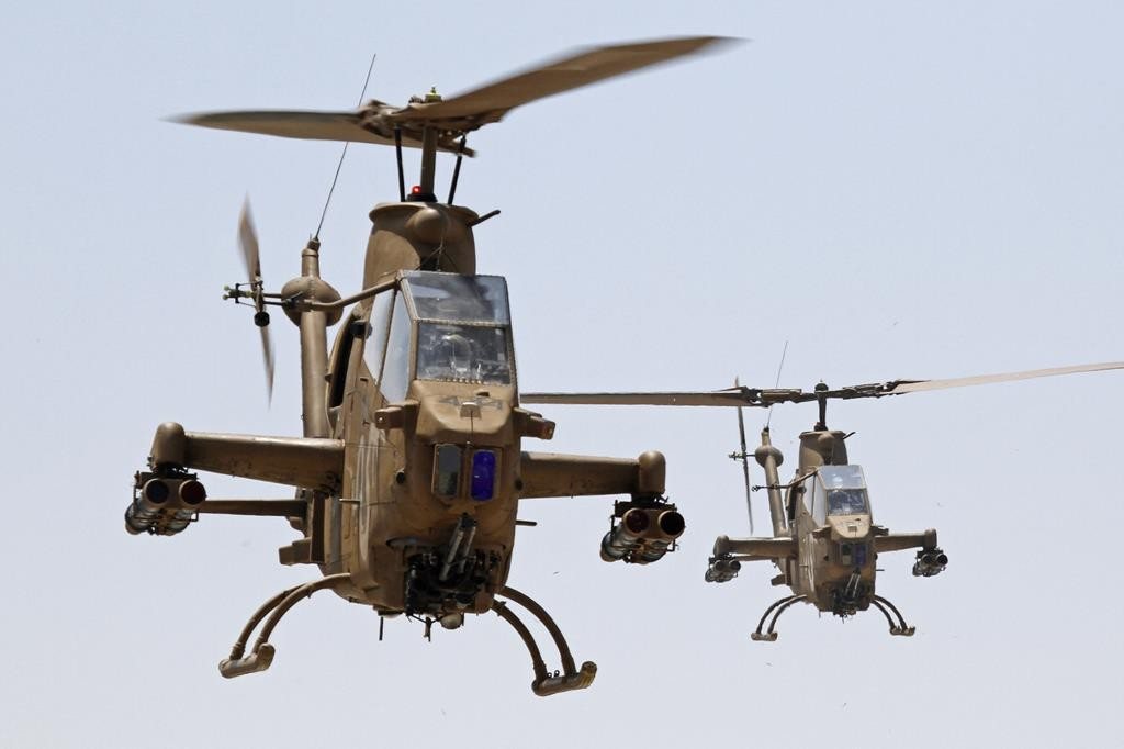 Israeli air force combat Cobra AH-1 helicopters in flight. ( Ofer Zidon/Flash90)