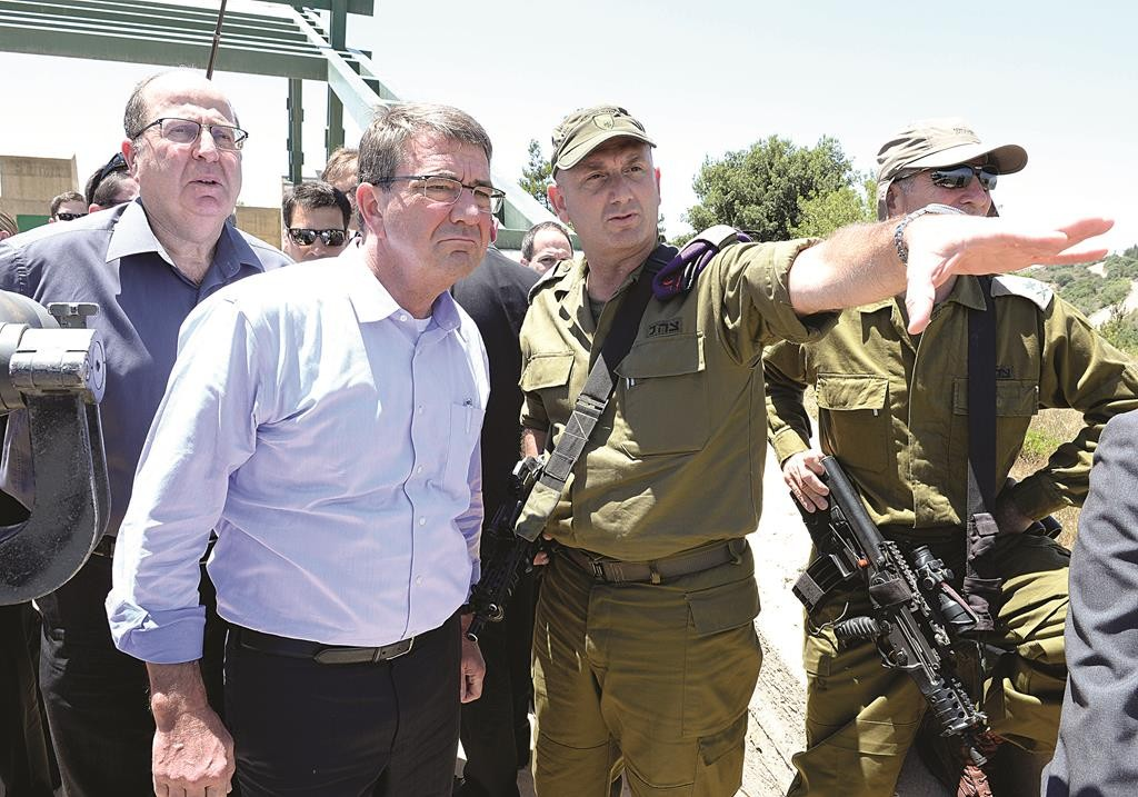 Defense Minister Moshe Yaalon (L) with U.S. Defense Secretary Ash Carter (2nd L) at the Hussein Lookout during a visit to the Hula Valley in northern Israel on Monday. (Matty Stern/US Embassy Tel Aviv)
