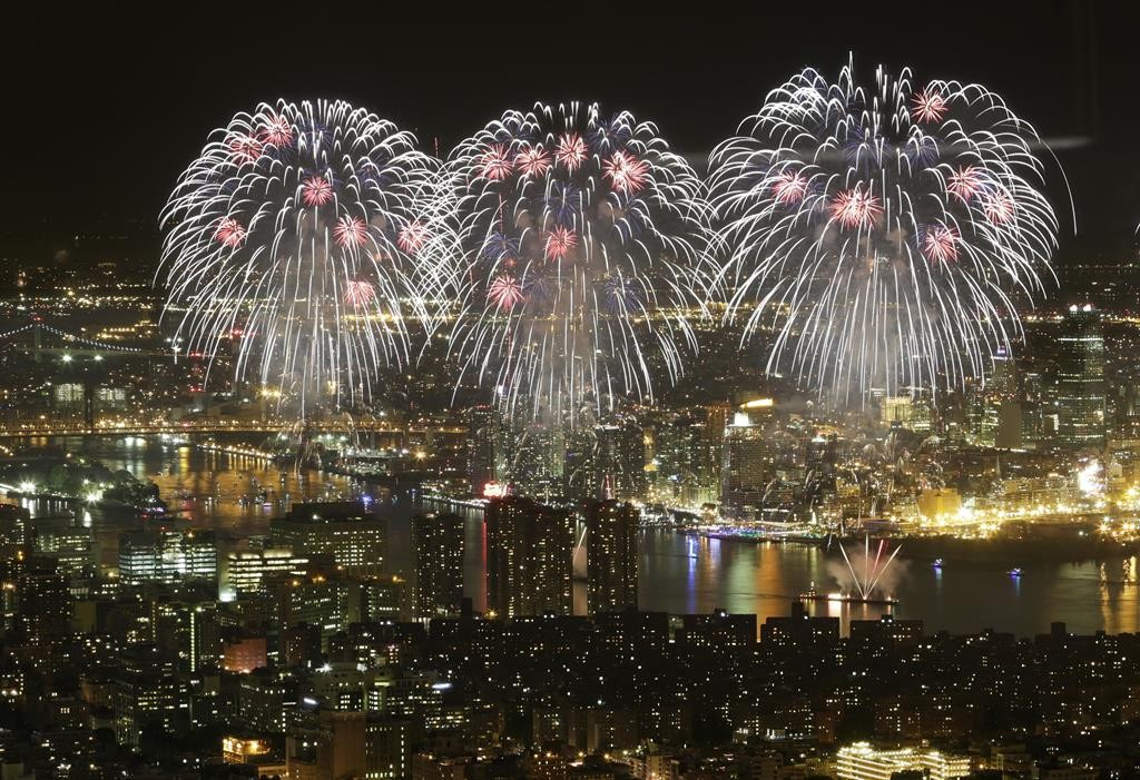 Fourth of July fireworks on Saturday light up the sky over the East River. (AP Photo/Mark Lennihan)