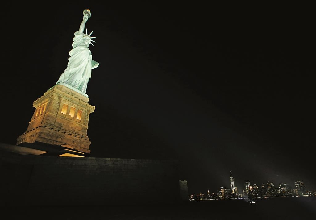 New LEDs illuminate the Statue of Liberty on Tuesday night. (AP Photo/Kathy Willens)