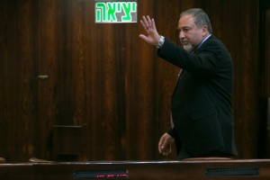 """The sign behind Avigdor Lieberman says """"Exit,"""" but he could be on his way back into the coalition. (Miriam Alster/Flash90)"""