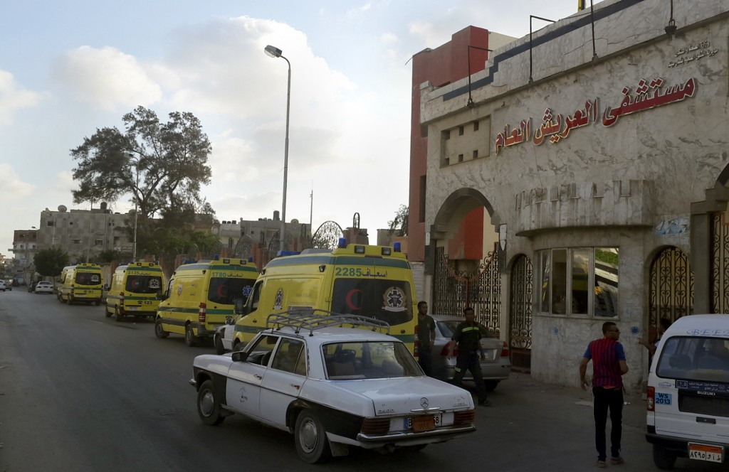 Ambulances wait in front of the El Arish International hospital because the road to Sheikh Zuweid, where numerous assaults against the army are ongoing, is not safe, in El Arish, north Sinai, Egypt. Dozens of Islamic terrorists unleashed a wave of simultaneous attacks, including suicide car bombings, on Egyptian army checkpoints Wednesday. (AP Photo/Muhamed Sabry)