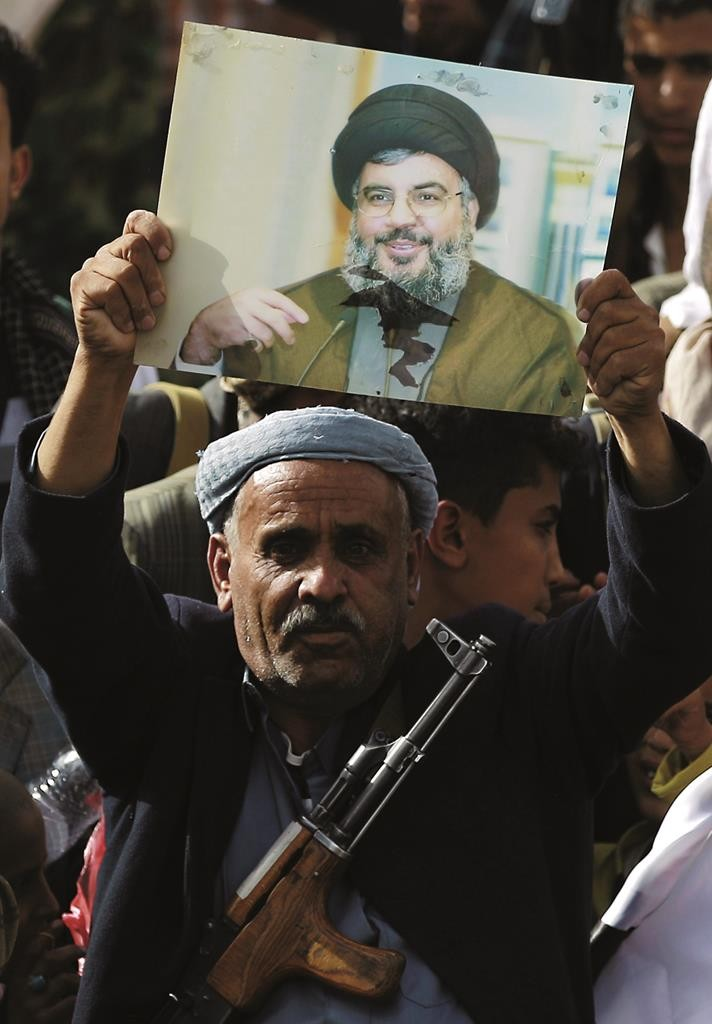 A Yemeni supporter of the Shiite Houthi movement holds a portrait of Hassan Nasrallah, the head of Lebanon's Shiite terrorist group Hizbullah, during a recent rally in the capital Sanaa. (Mohammed Huwais/AFP/Getty Images)
