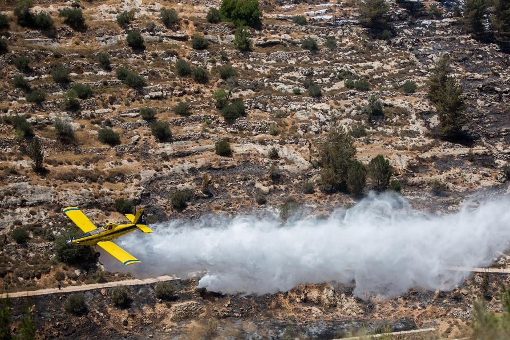 Israeli firefighter airplanes dousing a large fire near Ein Yael on Sunday. (Sindel/Flash90)
