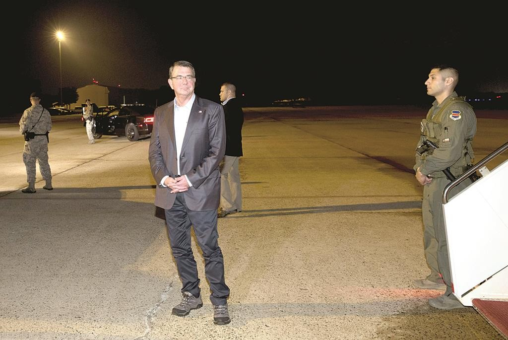 U.S. Defense Secretary Ash Carter pauses on the tarmac as he boards his plane en route to Israel, at Andrews Air Force Base, Maryland, early Sunday.  (REUTERS/Carolyn Kaster/Pool)