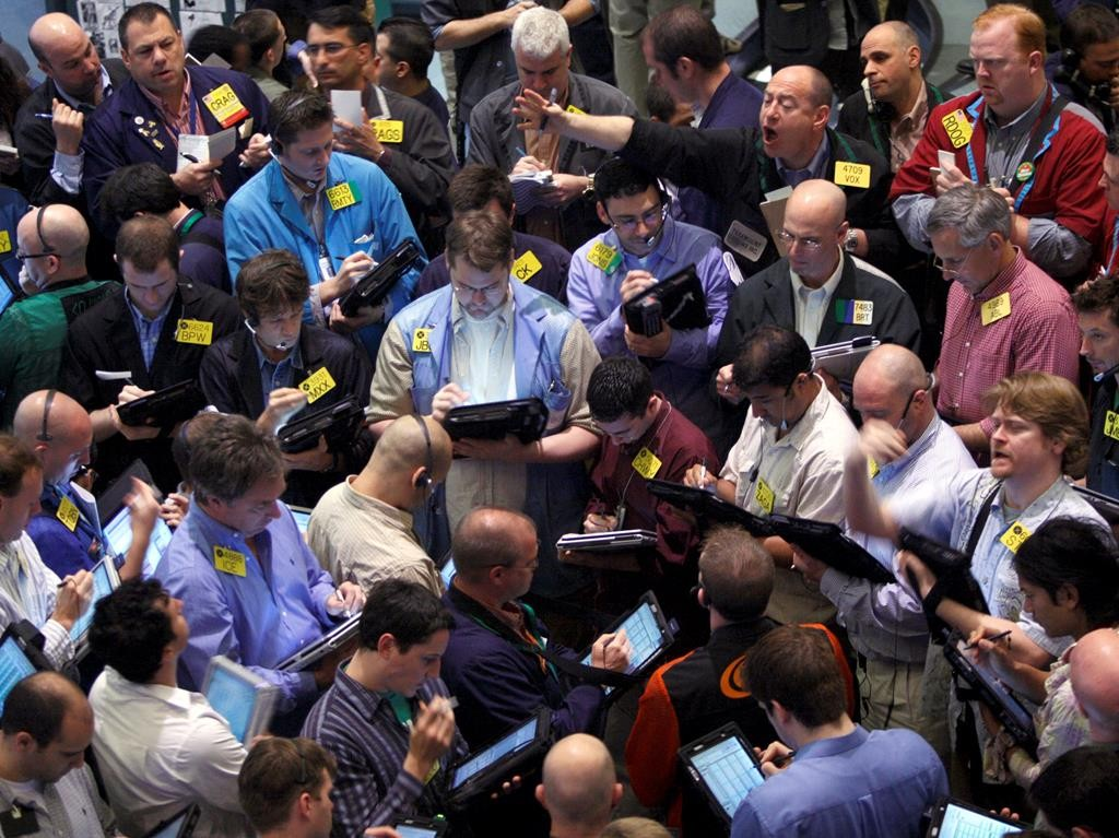 Traders deal on the floor of the New York Mercantile Exchange on April 21, 2008. (AP Photo/Jin Lee)