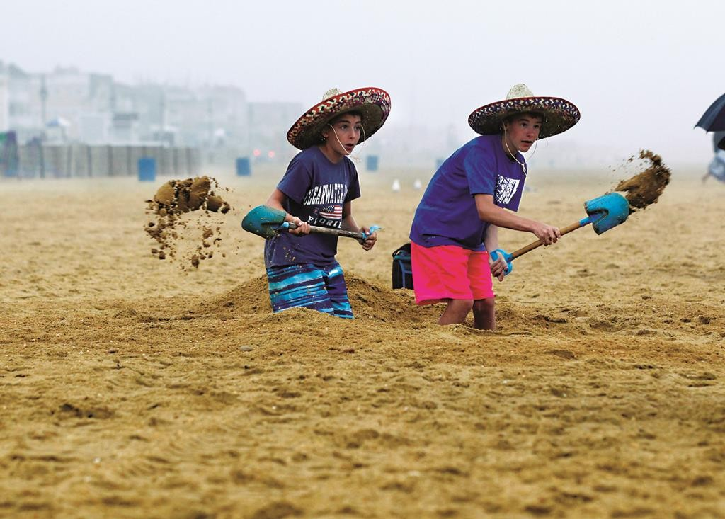 "Logan Dennison, 13 (R) and Vincent Impresa, 12, on Wednesday dig sand on the beach in the rain during the ""NJ Sandcastle Contest,"" contest in Belmar, N.J. (AP Photo/Mel Evans)"