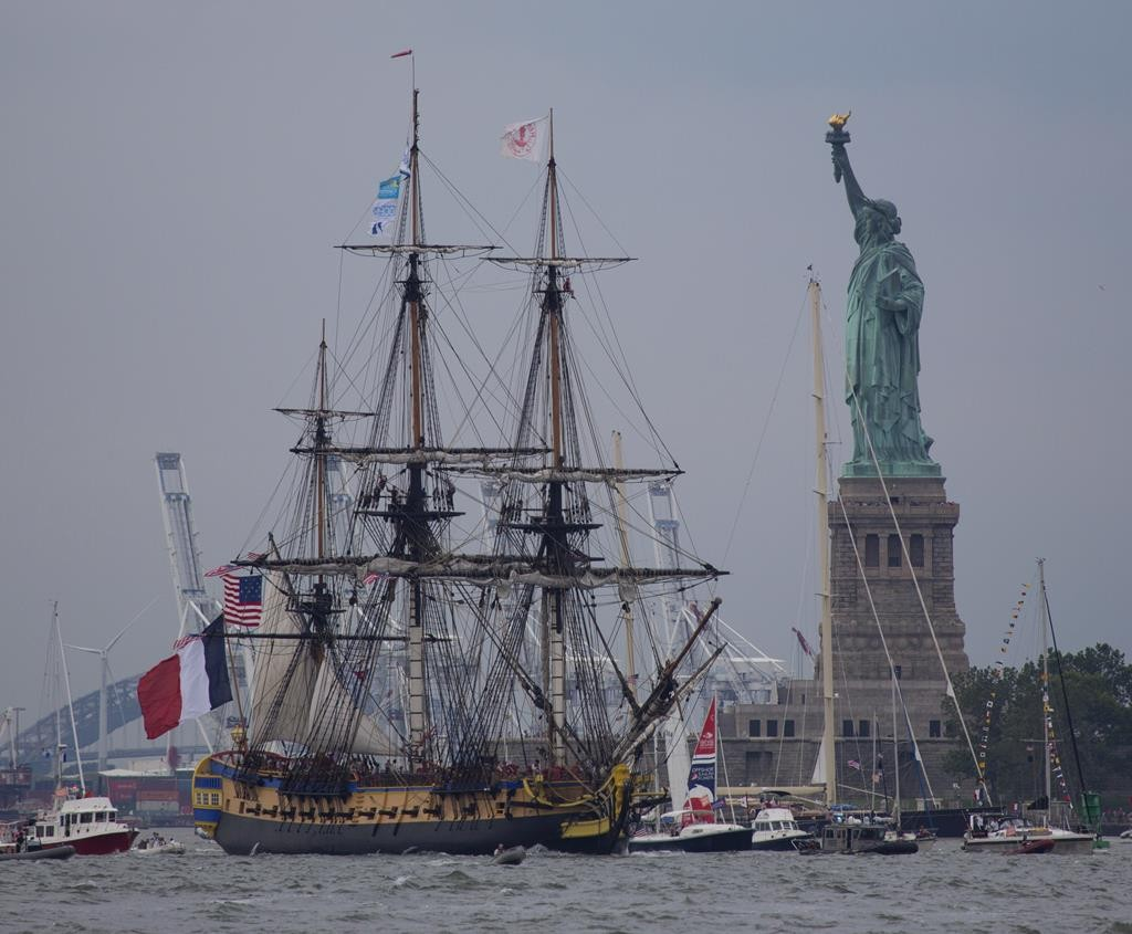 The tall ship Hermione on Saturday passes near the Statue of Liberty as it leads the Lafayette Parade of ships up the Hudson River. (AP Photo/Craig Ruttle)