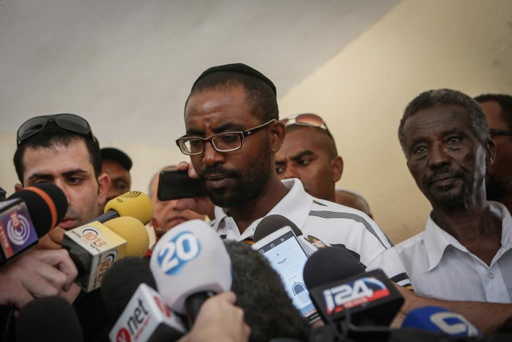 Family members of Avraham Mengistu appeal to Hamas to allow him to return home safely, Thursday at a press conference in Ashkelon. (Miriam Alster/Flash90)