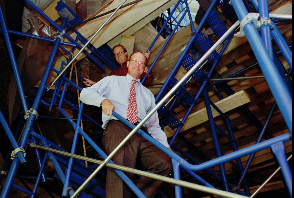 John Whitman in 1997 descends scaffolding in the Statehouse rotunda in Trenton. (AP Photo/Jeff Zelevansky)