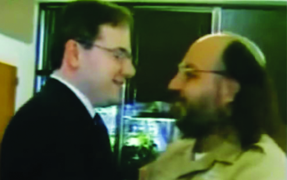 FILE PHOTO: Jonathan Pollard meeting with a visitor. (Web Video)