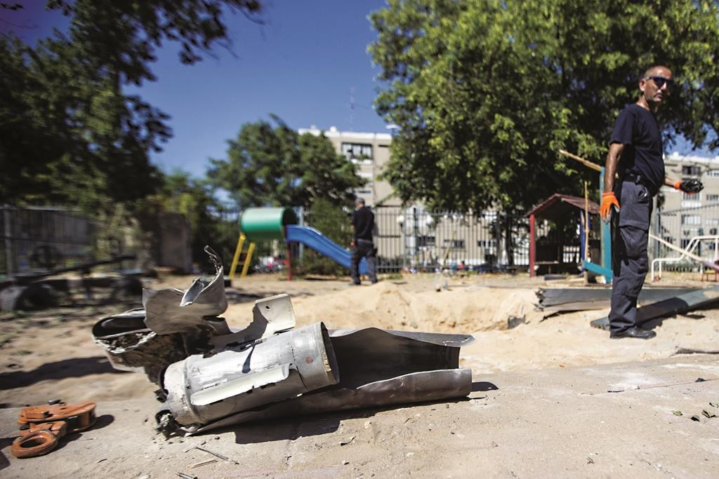 The remains of a rocket, fired by Palestinian terrorists from the Gaza Strip, after it landed in the courtyard of a kindergarten in Ashdod, August, 2014. (JACK GUEZ/AFP/Getty Images/File photo)