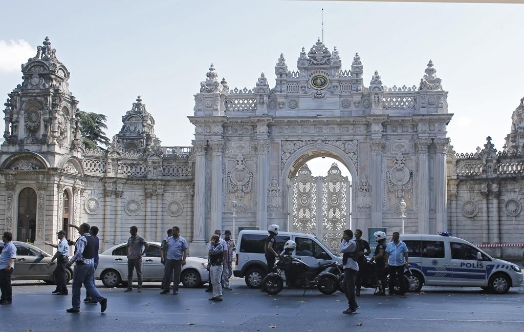 Turkish police secure the area after a shooting incident near the entrance to Dolmabahce Palace in Istanbul, Turkey Wednesday. (REUTERS/Murad Sezer)