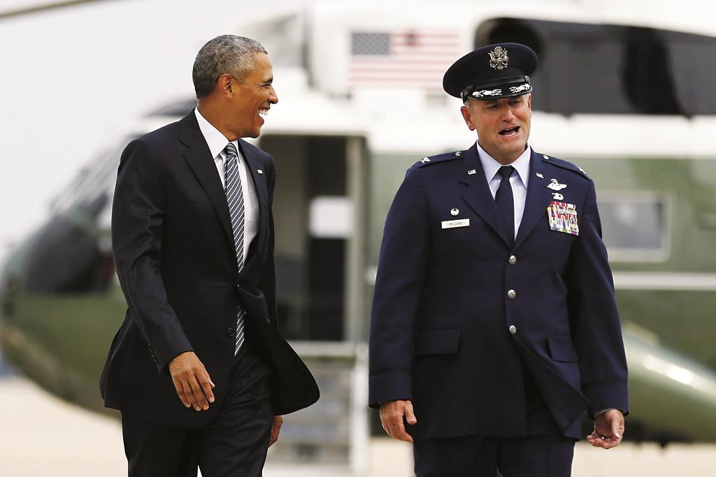 President Obama walks with U.S. Air Force Colonel John Millard as he arrives to board Air Force One for travel to Alaska from Joint Base Andrews, Maryland, Monday.  (AP Photo/Susan Walsh - Reuters/Jonathan Ernst)