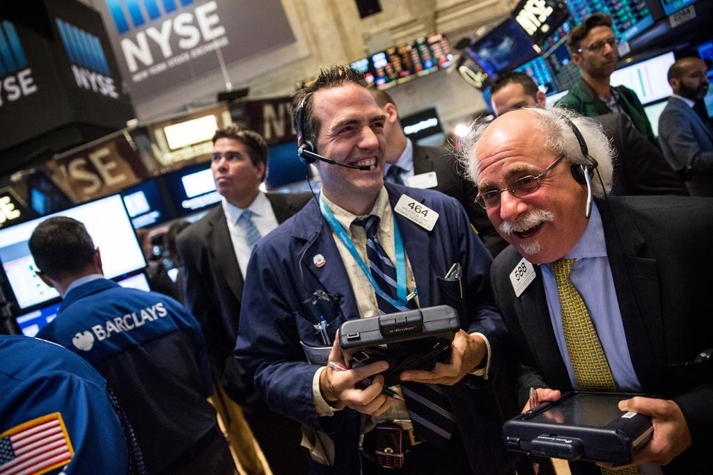 Traders work on the floor of the New York Stock Exchange on Wednesday morning in New York City. (Andrew Burton/Getty Images)