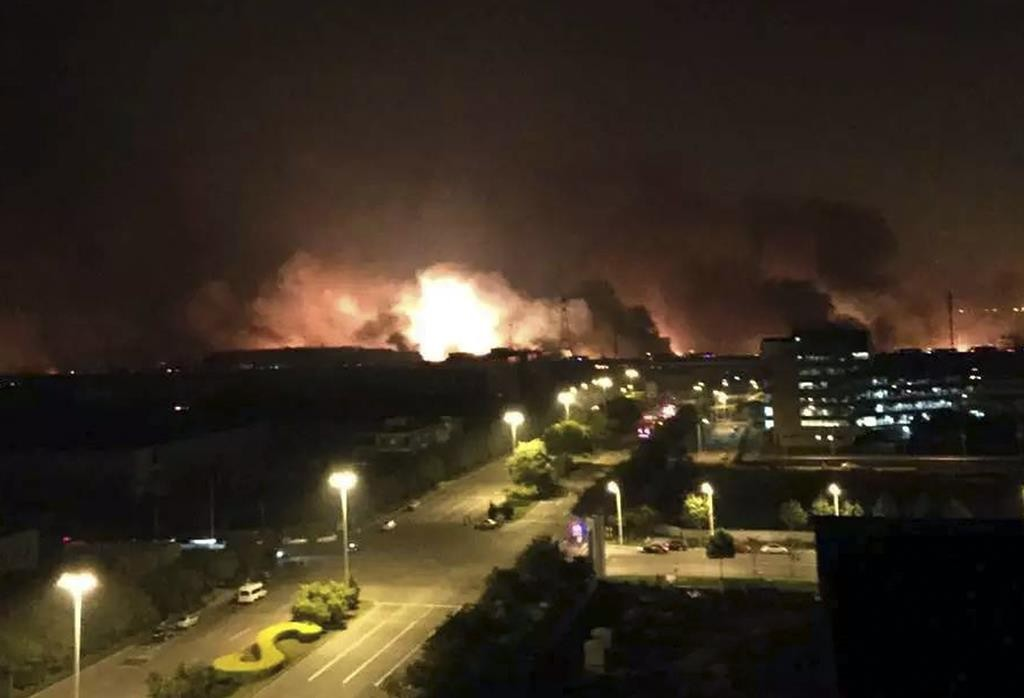 In this photo released by Xinhua News Agency, smoke and fire erupt into the night sky after an explosion in the Binhai New Area in north China's Tianjin Municipality on Thursday.  (Yue Yuewei/Xinhua via AP)