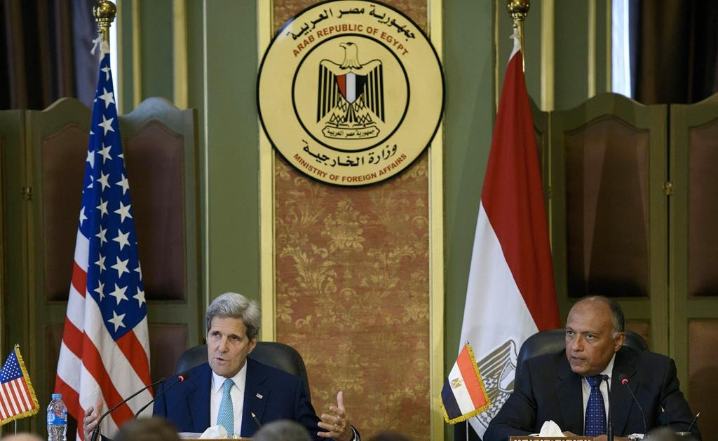 U.S. Secretary of State John Kerry, left, and Egypt's Foreign Minister Sameh Shoukry attend a press conference after their meeting at the foreign ministry in Cairo, Egypt, Sunday. (Brendan Smialowski/Pool Photo via AP)