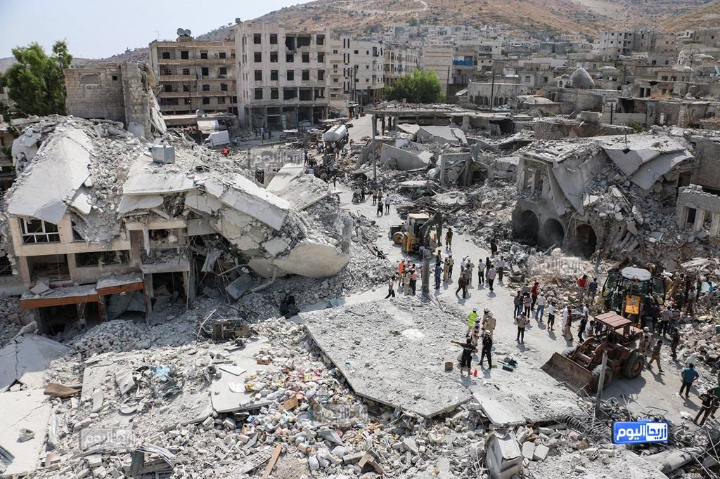 This photo provided by the Syrian anti-government activist group Ariha Today, shows the scene after a government warplane crashed in the center of the town of Ariha, in the northwestern province of Idlib, Syria, Monday. Air raids and the subsequent crash of a Syrian warplane in a residential area in the northwestern town of Ariha on Monday killed and wounded dozens of people, two activist groups said. (Ariha Today via AP)