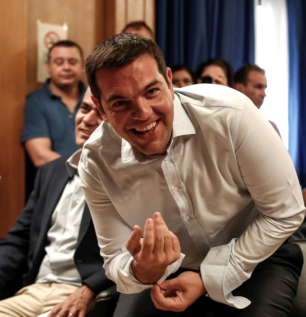 """Greece's prime minister, Alexis Tsipras, attending a gathering at the Agriculture Ministry in Athens. Tsipras said his country was at the """"final stage"""" of talks for a new bailout. (AP Photo/Yorgos Karahalis)"""