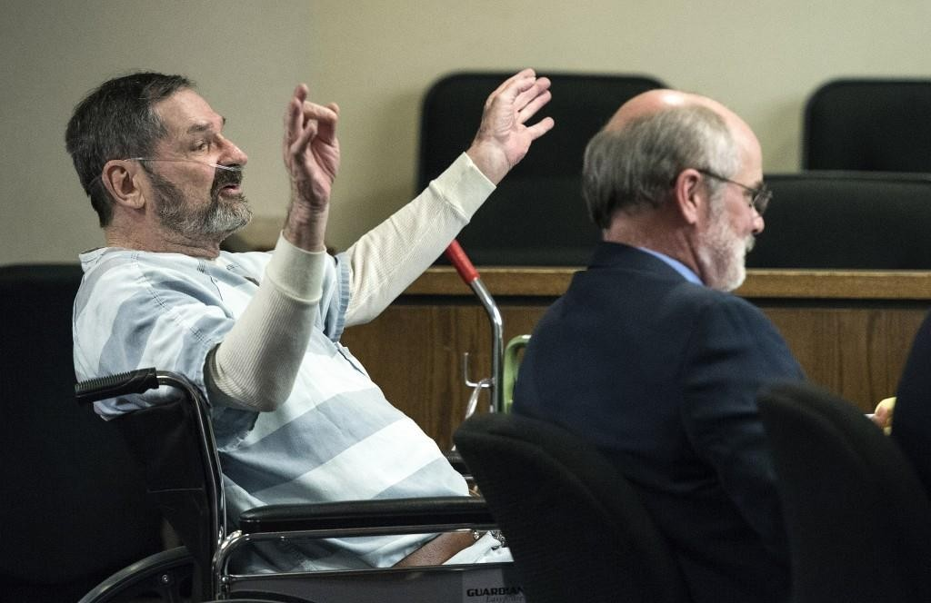 Frazier Glenn Miller (L), shown here at the Johnson County Courthouse in Olathe, Kan., in March. Jury selection for Miller's trial began Monday.  (John Sleezer/The Kansas City Star via AP)