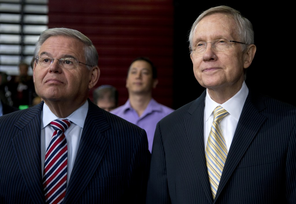 Democratic Senators Harry Reid of Nevada, right, and Robert Menendez of New Jersey. (AP Photo/Carolyn Kaster)