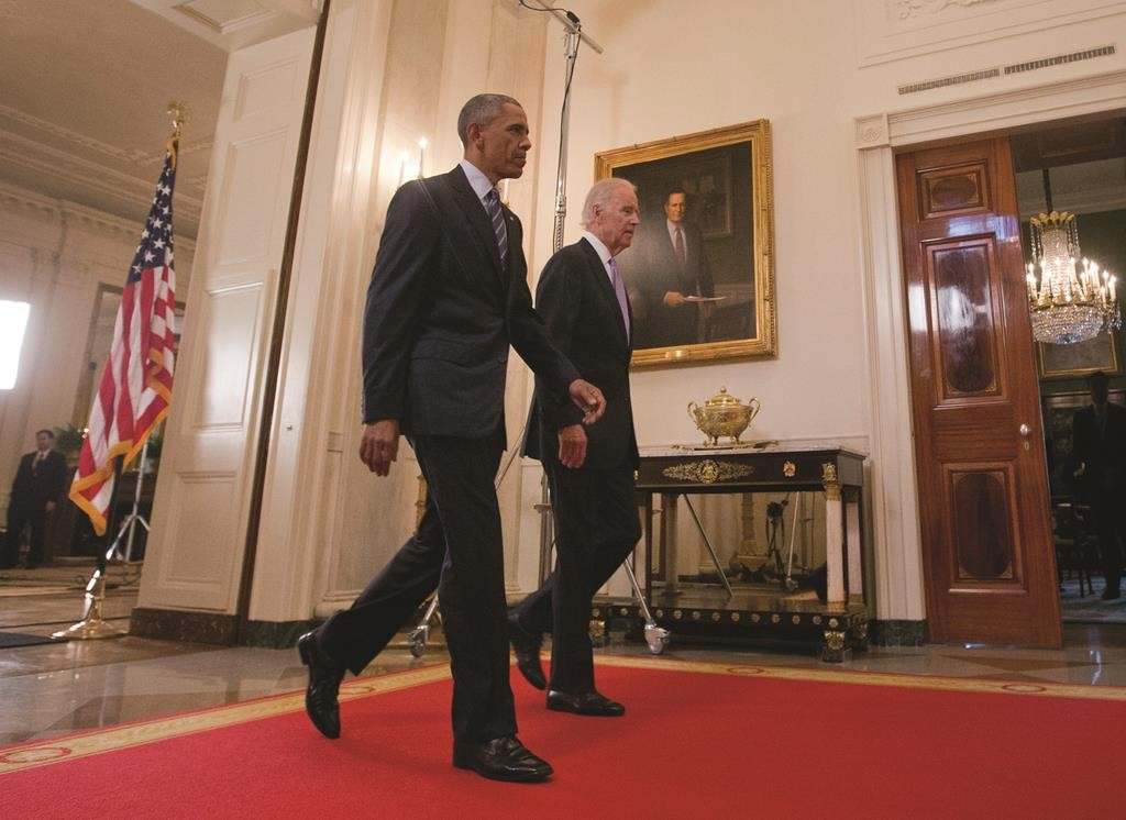 President Barack Obama walks with Vice President Joe Biden, after delivering remarks in the East Room of the White House in Washington, Tuesday, July 14, 2015, after an Iran nuclear deal is reached. (AP Photo/Pablo Martinez Monsivais)