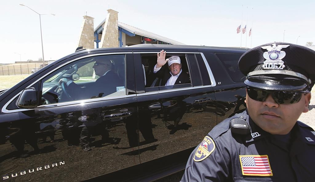 Republican presidential hopeful Donald Trump waves from his vehicle during a tour of the World Trade International Bridge at the U.S. Mexico border in Laredo, Texas, Thursday, July 23, 2015.  (AP Photo/LM Otero)