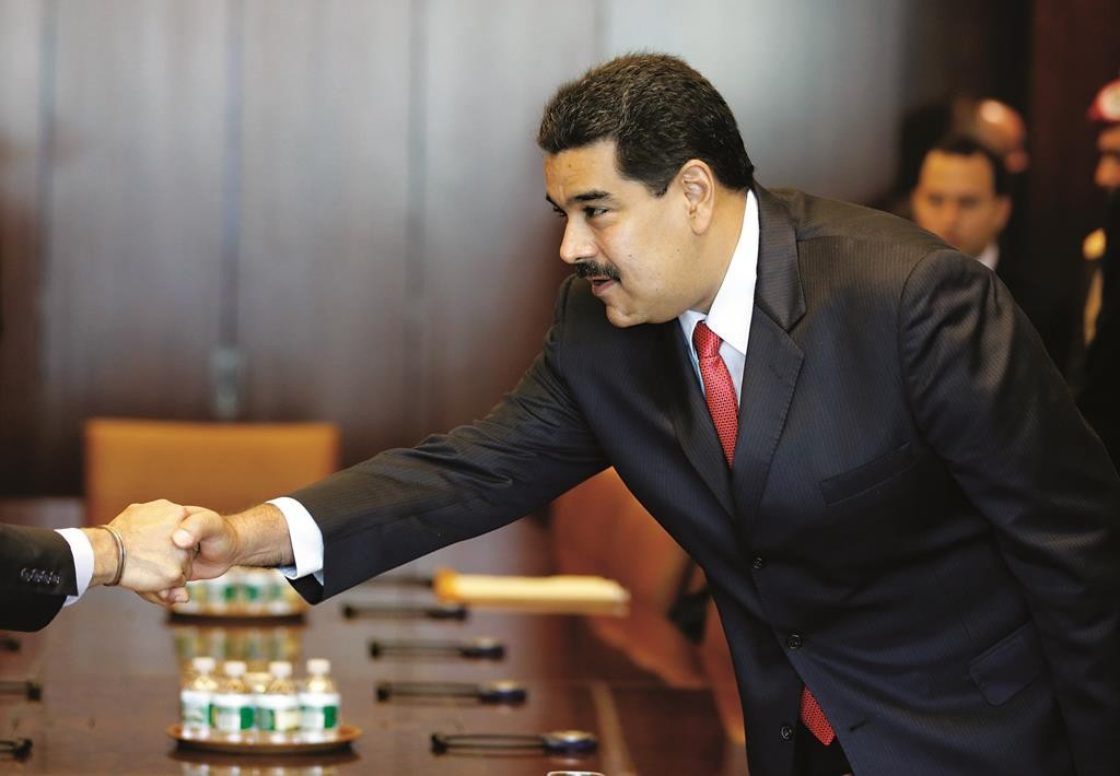 Venezuelan President Nicolas Maduro greets people before a meeting with United Nations Secretary-General Ban Ki-moon at U.N. headquarters, Tuesday, July 28. (AP Photo/Seth Wenig)