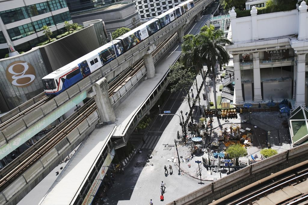 The Erawan Shrine, and Rajprasong intersection remains closed in Bangkok, Thailand, Tuesday, as investigations continue the morning after an explosion.  (AP Photo/Sakchai Lalit)