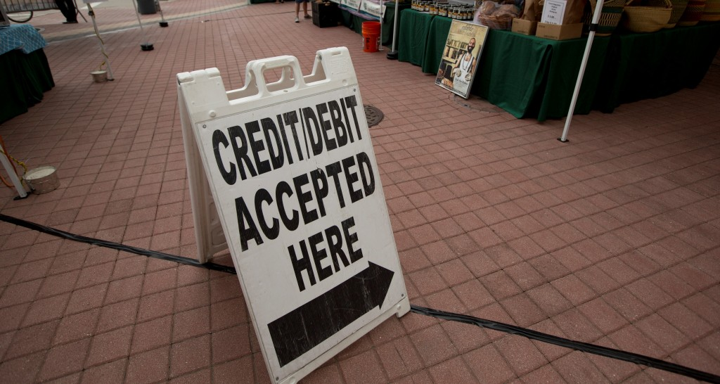 A credit-card pay station at the green market in downtown Miami. (AP Photo/J Pat Carter)