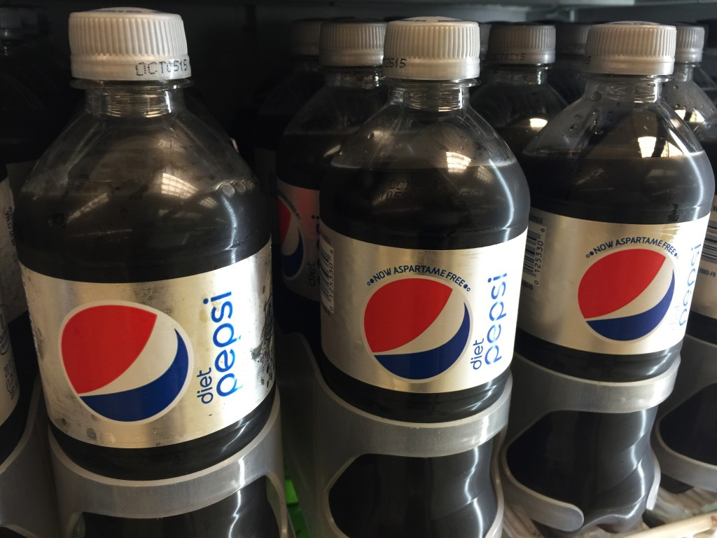 Bottles of Diet Pepsi with aspartame, left, and without aspartame, center and right, sit in a case at a store in New York. (AP Photo/Candice Choi)