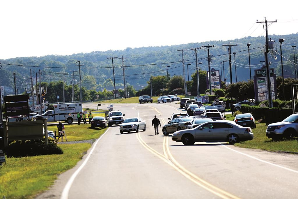 Authorities block Booker T. Washington Highway at Bridgewater Plaza, Wednesday, in Moneta, Va., after two journalists were fatally shot while broadcasting live from the plaza earlier in the day.  (Stephanie Klein-Davis/The Roanoke Times via AP)