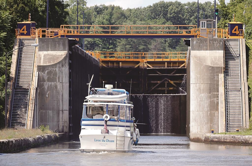 A boat enters Lock 4 of the Erie Canal in Waterford, NY, last week Tuesday. (AP Photo/Mike Groll)