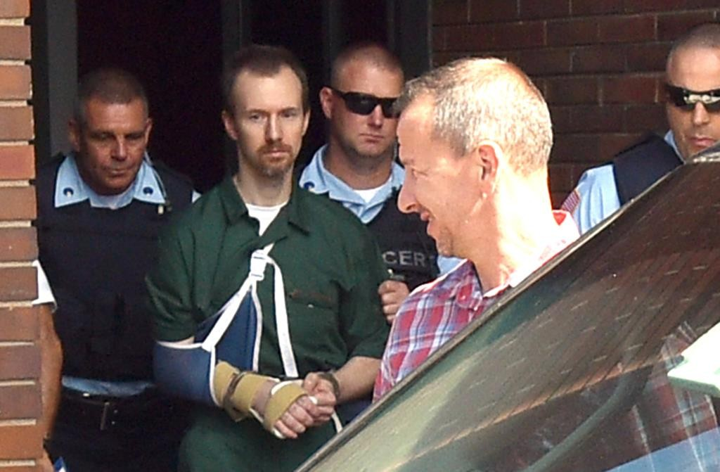 David Sweat, his arm in a sling, is led Thursday into Clinton County Court to be arraigned. (Rob Fountain/Press-Republican via AP)