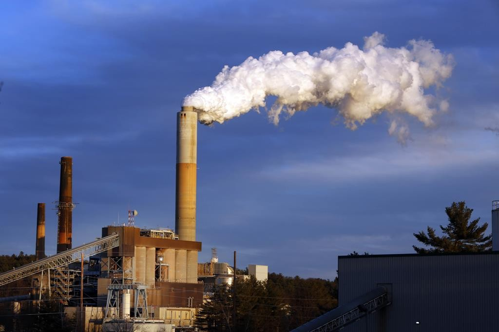 A plume of steam billows from the coal-fired Merrimack Station in Bow, NH. (AP Photo/Jim Cole, File)