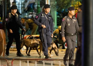 Police investigate the scene after an explosion in Bangkok, Monday. (AP Photo/Mark Baker)