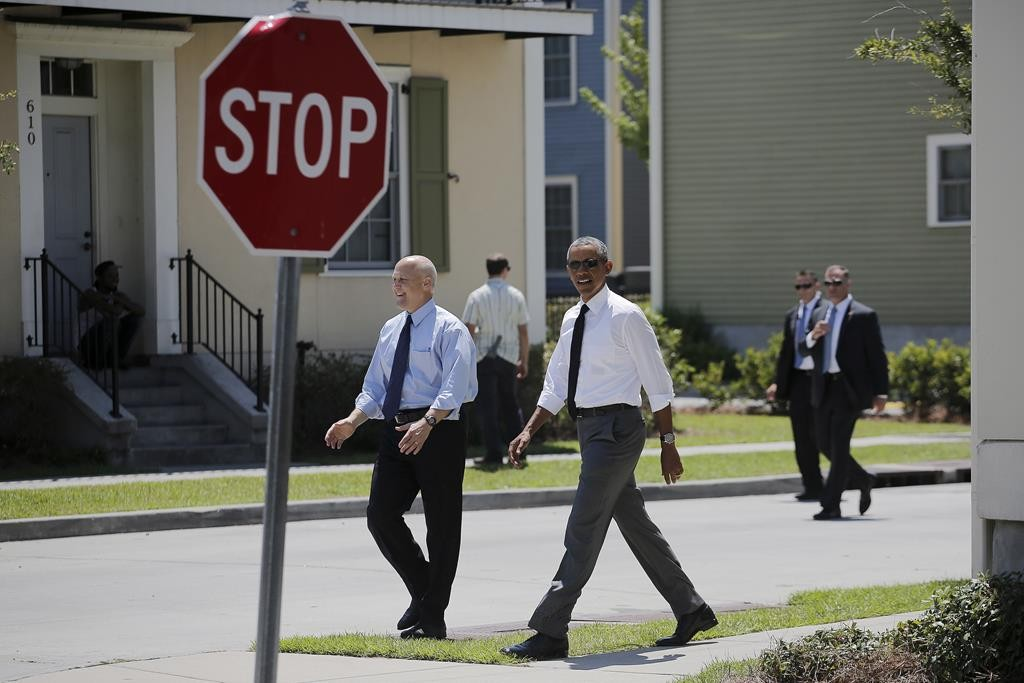 President Barack Obama (R) and New Orleans mayor Mitch Landrieu (L) visit an area of New Orleans, Louisiana, Thursday. The area was reconstructed after Hurricane Katrina. (REUTERS/Carlos Barria)