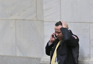 A trader talks on his phone in front of the New York Stock Exchange, Monday.  (AP Photo/Seth Wenig)