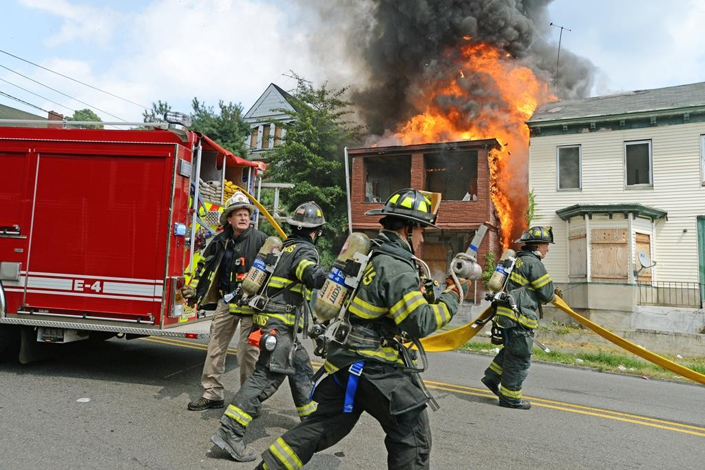 Firefighters on Wednesday respond to a fire in Paterson, N.J. (Viorel Florescu/The Record via AP)