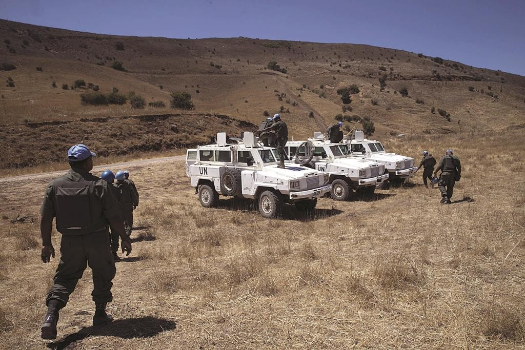 Fijian members of the United Nations Disengagement Observer Force (UNDOF), patrol the area near the ceasefire line between Israel and Syria, in the Golan Heights. (REUTERS/Baz Ratner)