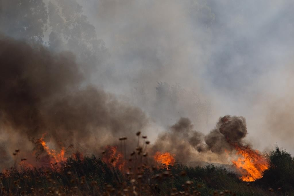 A fire rages near Kfar Szold, caused by shells fired from the Syrian side of the Israeli-Syrian border, which landed in open areas of Israel, Thursday.  (Basel Awidat/Flash90)