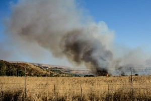 A large fire raging near Kfar Szold, caused by projectiles fired from the Syrian side of the Israeli-Syrian border and hitting open areas on Thursday. (Basel Awidat/Flash90)