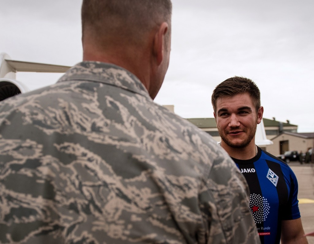 Oregon National Guardsman Aleksander Skarlatos (R) meets Brig. Gen. Jon T. Thomas, 86th Airlift Wing commander, as he arrives at Ramstein Air Base, Germany. (Staff Sgt. Sara Keller/U.S. Air Force via AP)