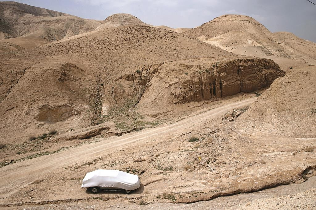 A car covered for protection from the sun and heat in one of Israel's hottest spots, near the Dead Sea. (Nati Shohat/Flash 90)