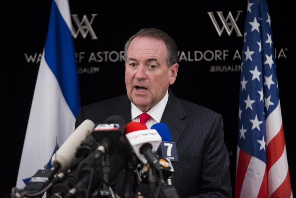 Republican presidential candidate Mike Huckabee at a press conference in the Waldorf Astoria Hotel in Yerushalayim on Tuesday. (Yonatan Sindel/Flash90)