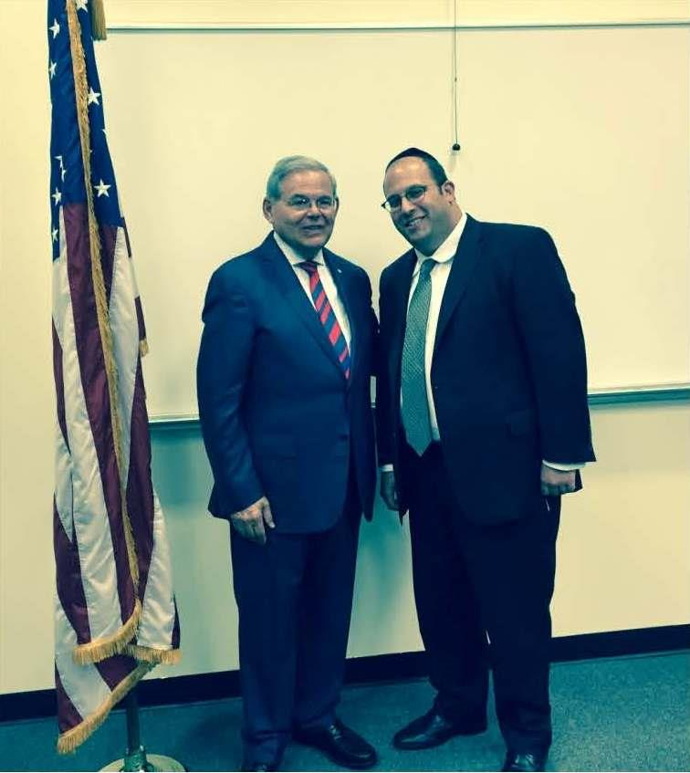 Rabbi Avi Schnall (R) on Tuesday meets Sen. Bob Menendez after his Seton Hall University address on the Iran deal. (Agudath Israel)