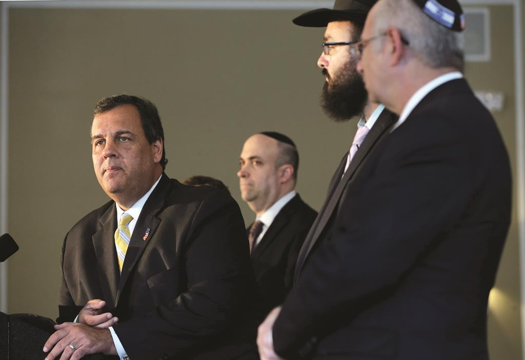 New Jersey Gov. Chris Christie listens to a question as he stands with Jewish leaders at the Chabad House at Rutgers University on Tuesday. (AP Photo/Mel Evans)